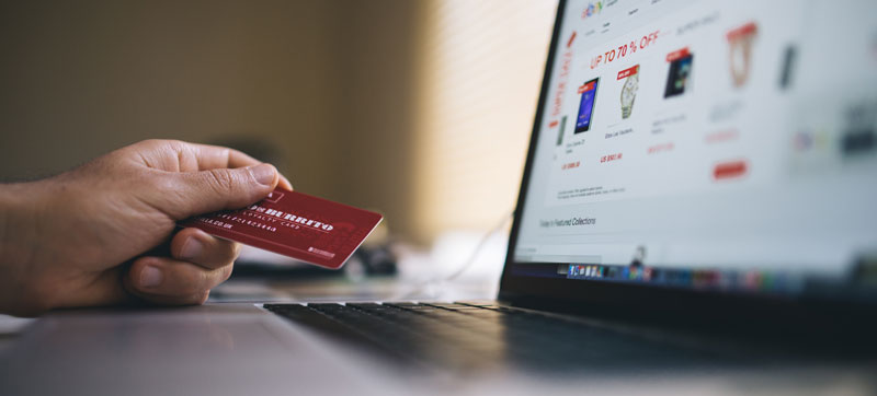 Shopping online with credit card stock image
